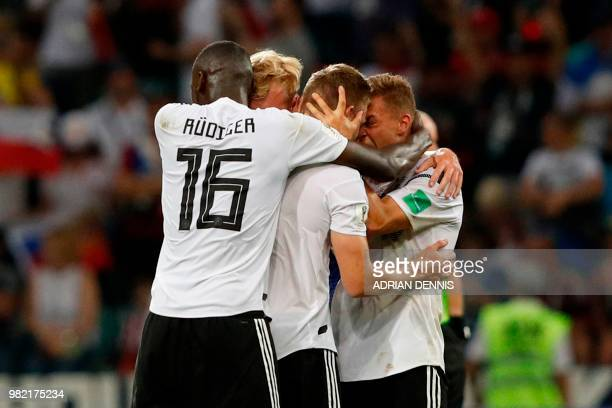 TOPSHOT Germany's midfielder Toni Kroos celebrates scoring the 21 goal with his teammates during the Russia 2018 World Cup Group F football match...