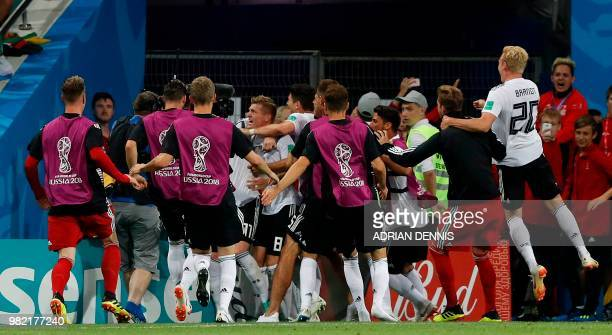 Germany's midfielder Toni Kroos celebrates scoring the 21 goal with his teammates during the Russia 2018 World Cup Group F football match between...