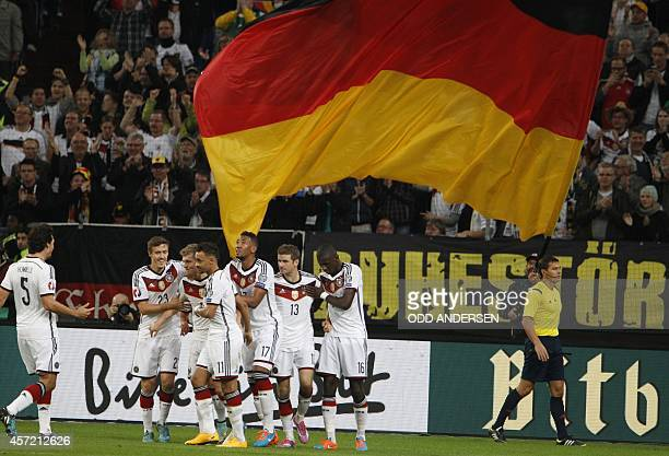 Germany's midfielder Toni Kroos celebrates scoring with his team-mates during the UEFA Euro 2016 Group D qualifying football match Germany vs...