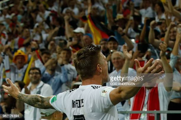 Germany's midfielder Toni Kroos celebrates with supporters after scoring a goal during the Russia 2018 World Cup Group F football match between...