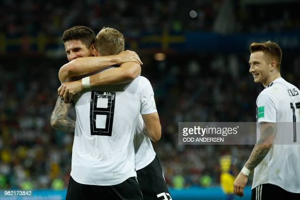 TOPSHOT Germany's midfielder Toni Kroos celebrates with teammates after scoring a goal during the Russia 2018 World Cup Group F football match...