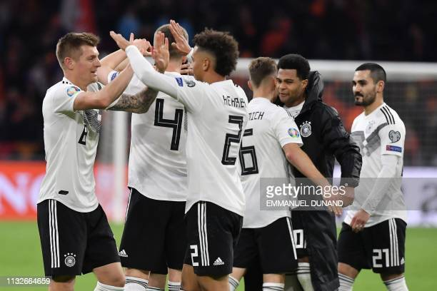 Germany's midfielder Toni Kroos celebrates with teammates their victory at the end of the UEFA Euro 2020 Group C qualification football match between...