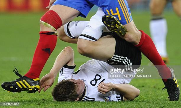 Germany's midfielder Toni Kroos fights for the ball with Spain's midfielder Xabi Alonso during the 2010 World Cup semifinal football match Germany vs...