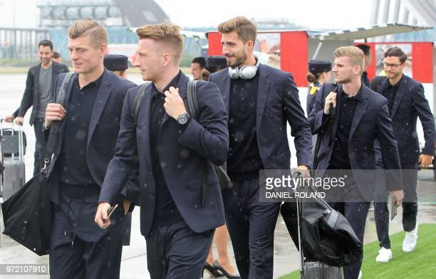 Germany's midfielder Toni Kroos forward Marco Reus goalkeeper Kevin Trapp and forward Timo Werner of the German national football team are about to...