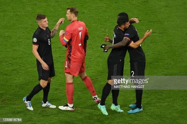 Germany's midfielder Toni Kroos, Germany's goalkeeper Manuel Neuer, Germany's forward Kevin Volland and Germany's defender Antonio Ruediger react...