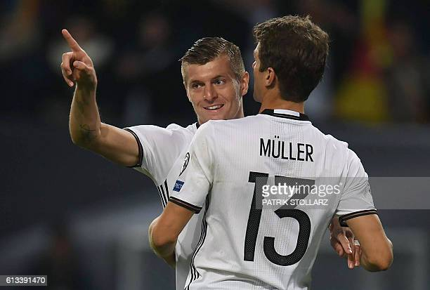 Germany's midfielder Toni Kroos is congratulated by Germany's midfielder Thomas Mueller after scoring the 20 during the 2018 World Cup qualifier...