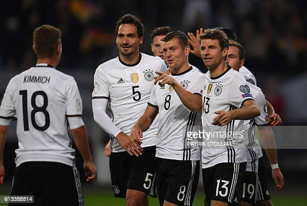 Germany's midfielder Toni Kroos is congratulated by his teammates after scoring the 20 during the 2018 World Cup qualifier football match of Germany...