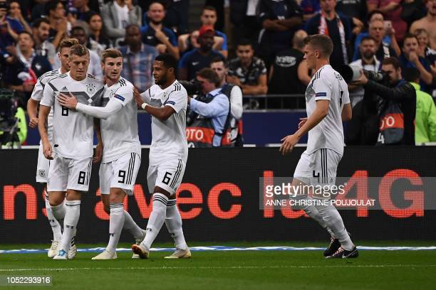 Germany's midfielder Toni Kroos is congratulated by teammates after scoring the opener on a penalty kick during the UEFA Nations League football...