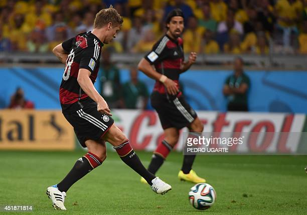 Germany's midfielder Toni Kroos is watched by teammate Germany's midfielder Sami Khedira as he scores during the semifinal football match between...