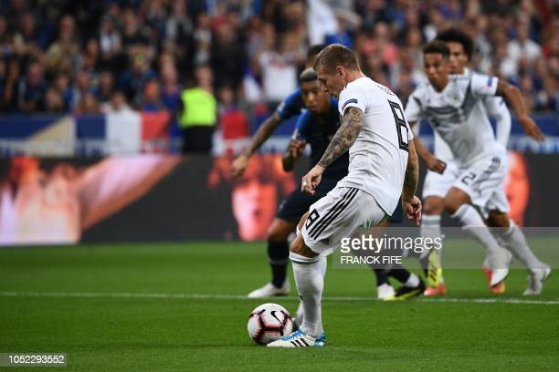 Germany's midfielder Toni Kroos kicks to score the opener on a penalty kick during the UEFA Nations League football match between France and Germany...