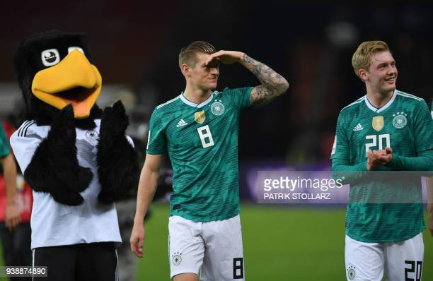 Germany's midfielder Toni Kroos reacts next to Germany's midfielder Julian Brandt after their international friendly football match between Germany...