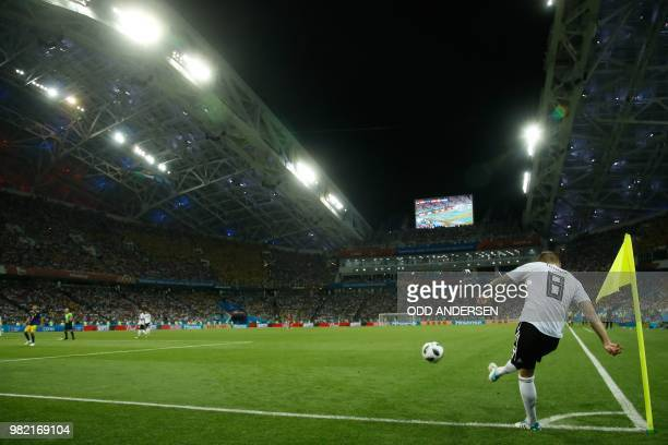 Germany's midfielder Toni Kroos shoots a corner kick during the Russia 2018 World Cup Group F football match between Germany and Sweden at the Fisht...