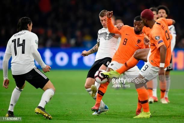 Germany's midfielder Toni Kroos vies with Netherlands' midfielder Georginio Wijnaldum during the UEFA Euro 2020 Group C qualification football match...