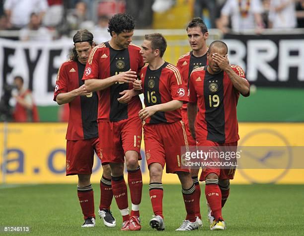 Germany's midfielder Torsten Frings Germany's midfielder Michael Ballack Germany's defender Philipp Lahm Germany's striker Miroslav Klose and...