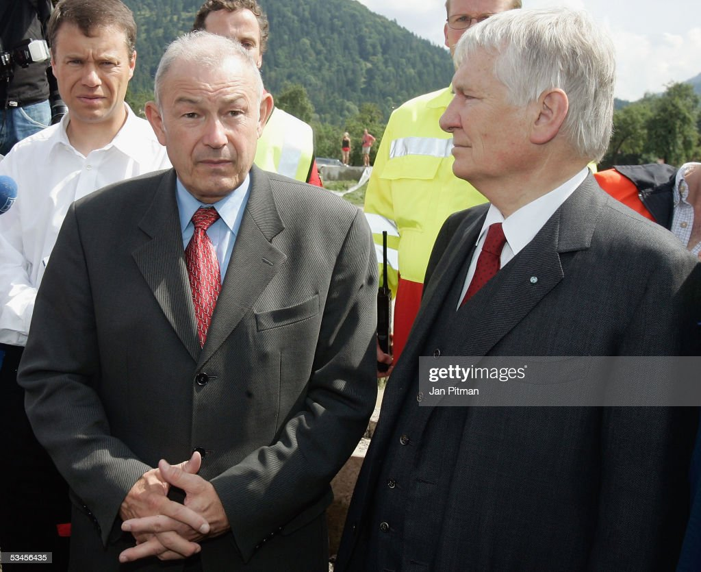 Germany's Minister for the Interior, Otto Schily, and Bavaria's Minister for the Interior, Guenther Beckstein, look on, August 24, 2005 in Eschenlohe, Germany. Flooding has caused thousands of people to abandon their homes in recent days, as transport links were cut, leaving many villages completely isolated. It is reported that at least 11 people are dead or missing in the floods that struck Germany, Austria and Switzerland. People in southern Bavaria are now cleaning up the streets and their homes as the water levels drop.
