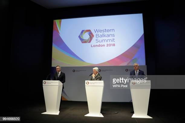 Germany's Minister of State for Europe Michael Roth speaks as British Minister of State for Europe and the Americas Alan Duncan center and Polish...