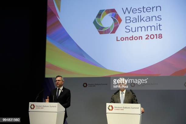 Germany's Minister of State for Europe Michael Roth speaks as British Minister of State for Europe and the Americas Alan Duncan and Polish Minister...