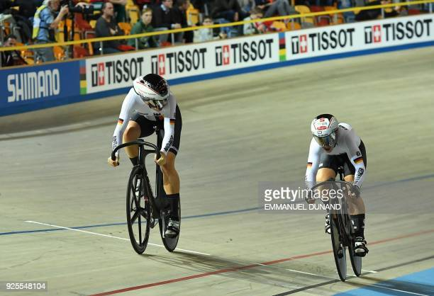 Germany's Miriam Welte and Kristina Vogel compete in the women's team sprint final race at The UCI World Cycling Championships in Apeldoorn on...