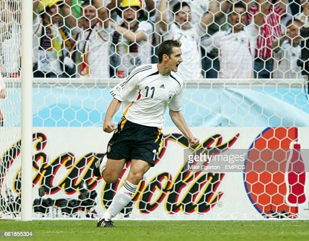 Germany's Miroslav Klose celebrates scoring his sides second goal of the game