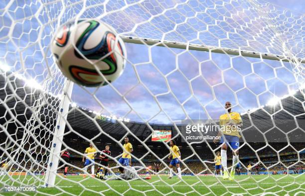 Germany's Miroslav Klose cheers after scoring the 0-2 goal during the FIFA World Cup 2014 semi-final soccer match between Brazil and Germany at...