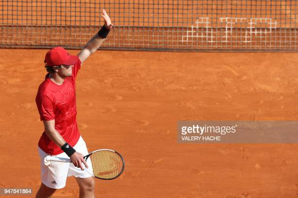 Germany's Mischa Zverev celebrates after winning his tennis match against France's Lucas Pouille during the MonteCarlo ATP Masters Series Tournament...