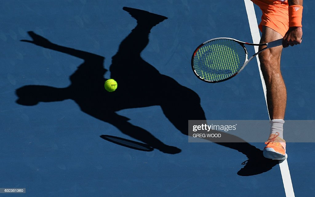 TOPSHOT - Germany's Mischa Zverev hits a return against Britain's Andy Murray during their men's singles fourth round match on day seven of the Australian Open tennis tournament in Melbourne on January 22, 2017. / AFP / GREG