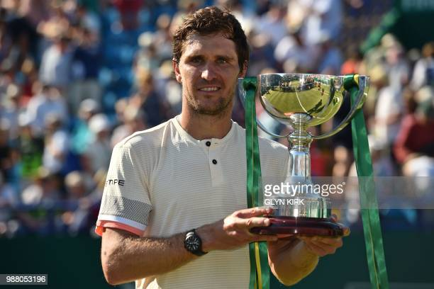 Germany's Mischa Zverev poses with the trophy after his victory over Slovakia's Lukas Lacko in the men's singles finals match at the ATP Nature...