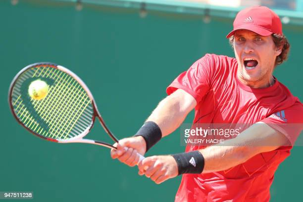 Germany's Mischa Zverev returns the ball to France's Lucas Pouille during their tennis match as part of the MonteCarlo ATP Masters Series Tournament...