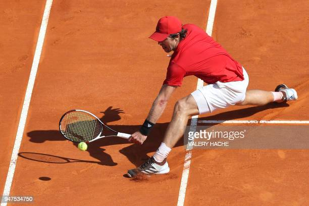 TOPSHOT Germany's Mischa Zverev returns the ball to France's Lucas Pouille during their tennis match as part of the MonteCarlo ATP Masters Series...