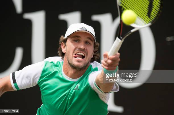 Germany's Mischa Zverev returns the ball to Spain's Feliciano Lopez in their semifinal match at the ATP Mercedes Cup tennis tournament in Stuttgart...