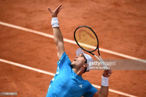 Germany's Mischa Zverev serves the ball to France's Richard Gasquet during their men's singles first round match on day two of The Roland Garros 2019...