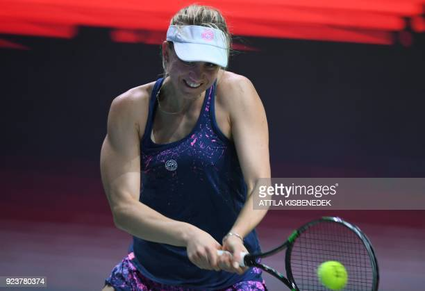 Germany's Mona Barthel plays a backhand against Slovakia's Dominika Cibulkova during their semifinal match of the WTA Hungarian Open Ladies' tennis...