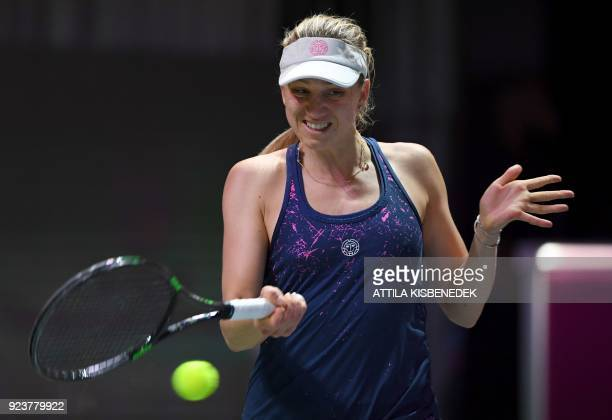 Germany's Mona Barthel plays a forehand against Slovakia's Dominika Cibulkova during their semifinal match of the WTA Hungarian Open Ladies' tennis...