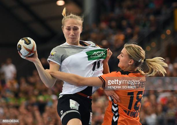 Germany's Nadja Mansson vies with Netherland's Kelly Dulfer during the preliminary round IHF Womens World Championship handball match Germany vs...