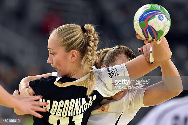 Germany's Nadja Nadgornaja vies with Montenegro's Andrea Klikovac during the Main Round Group 2 match Germany vs Montenegro of the 2014 Women's...