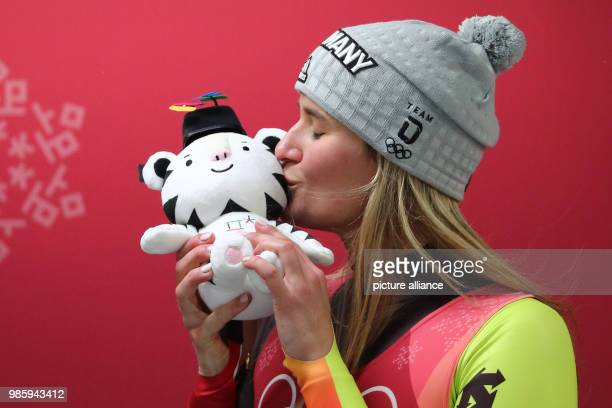 Germany's Natalie Geisenberger kisses mascot Soohorang as she celebrates winning gold in the women's single luge competetion on day four of the...