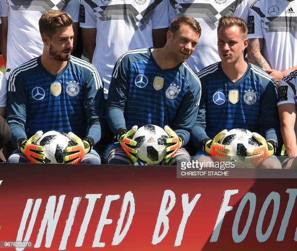 Germany's national football goalkeepers Kevin Trapp Manuel Neuer and MarcAndre Ter Stegen talk together during a team photo event at the Rungghof...