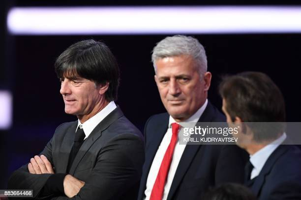 Germany's national football team coach Joachim Loew stands with Switzerland's Bosnian coach Vladimir Petkovic at the end of the 2018 FIFA World Cup...