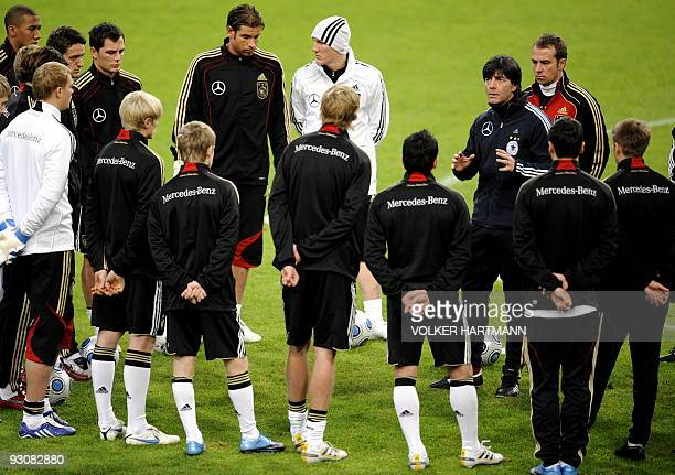 Germany's National football team head coach Joachim Loew gives instructions to the team during a training session on November 16 2009 in Duesseldorf...