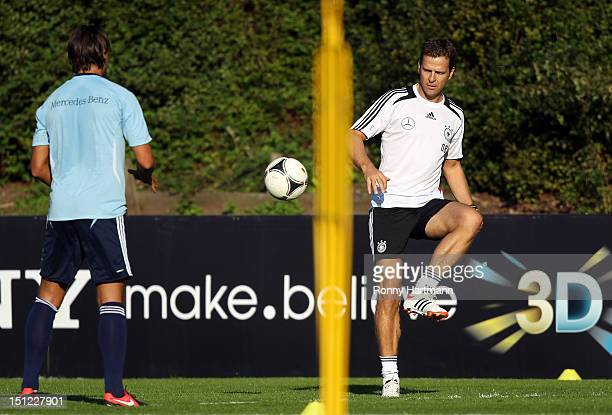 Germany's national football team manager Oliver Bierhoff and Sami Khedira attend a training session on September 04, 2012 in Barsinghausen, Germany,...