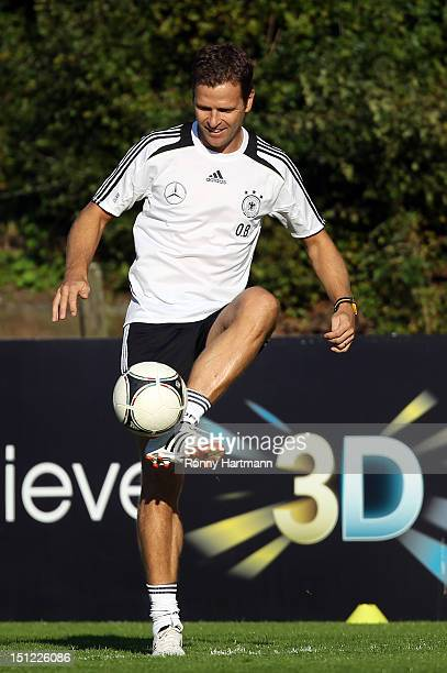 Germany's national football team manager Oliver Bierhoff controls the ball during a training session on September 04, 2012 in Barsinghausen, Germany,...