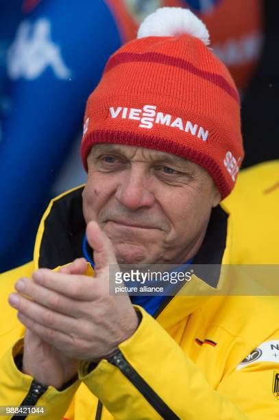 Germany's national luge coach Norbert Loch applauds at the finish line during the men's double at the Luge World Cup in Altenberg, Germany, 02...