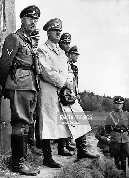 Germany's Nazi leader, Adolf Hitler , stands beside Heinrich Himmler , the head of the Gestapo, to observe a parade of Nazi Stormtroopers. Germany,...