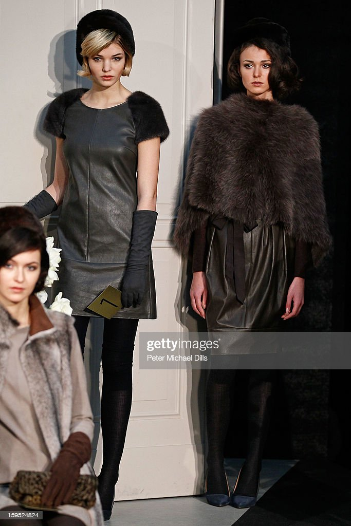'Germany's next Topmodel'candidate Luisa Hartema (L) poses at Schacky And Jones Show Autumn/Winter 2013/14 fashion show during Mercedes-Benz Fashion Week Berlin at Brandenburg Gate on January 15, 2013 in Berlin, Germany.