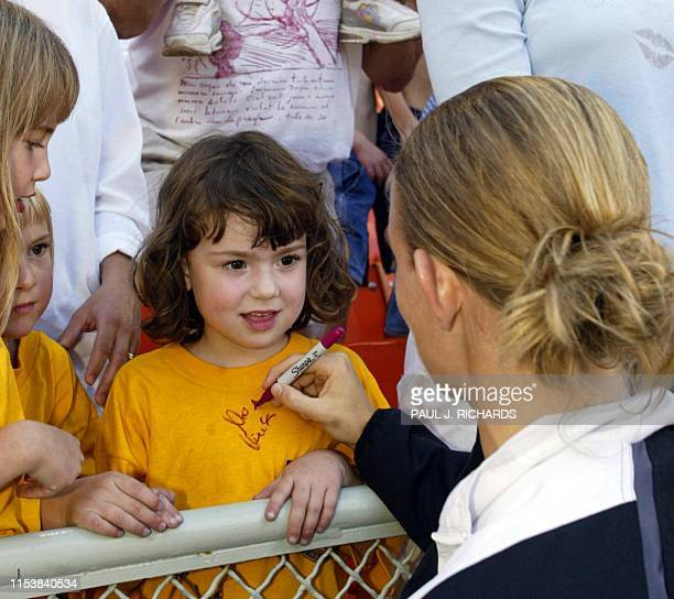 Germany's Nia Kuenzer signs an autograph for a young fan after the team's 61 victory over Argentina during their Group C soccer match in the 2003...