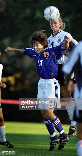 Germany's Nia Kunzer battles for a header with Japan's Mio Otani during the 2001 Nike US Women's Cup 09 September 2001 in Buffalo Grove Illinois AFP...