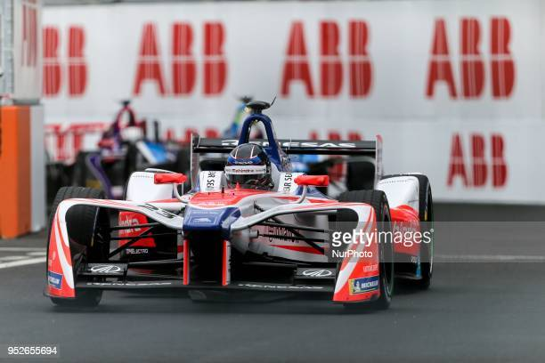 Germanys Nick Heidfeld of the Formula E team Mahindra competes during the French stage of the Formula E championship around The Invalides Monument...