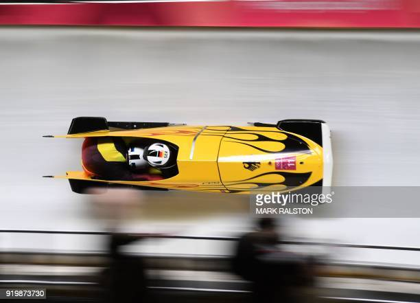 TOPSHOT Germany's Nico Walther and Germany's Christian Poser compete in the 2man bobsleigh heat 2 run during the Pyeongchang 2018 Winter Olympic...