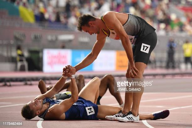 Germany's Niklas Kaul helps Estonia's Janek Oiglane after the Men's 1500m Decathlon final at the 2019 IAAF Athletics World Championships at the...