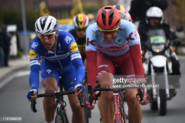 Germany's Nils Politt and Belgium's Philippe Gilbert lead with a group of riders during the 117th edition of the ParisRoubaix oneday classic cycling...